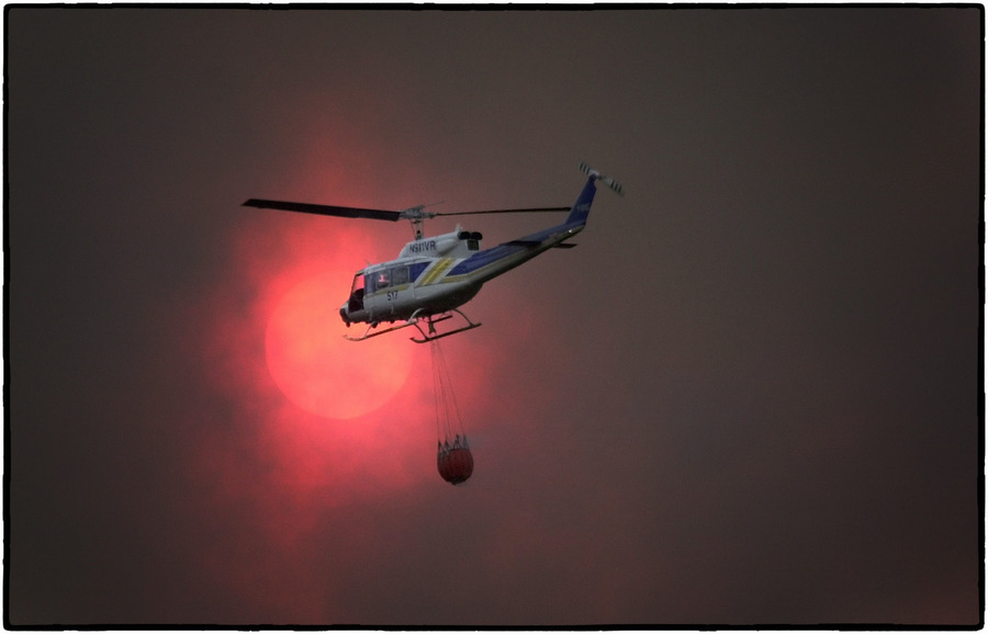 A helicopter carries water to a Wyoming wildfire. : The Aftermath Sessions : Oklahoma City Editorial and Documentary Photographer