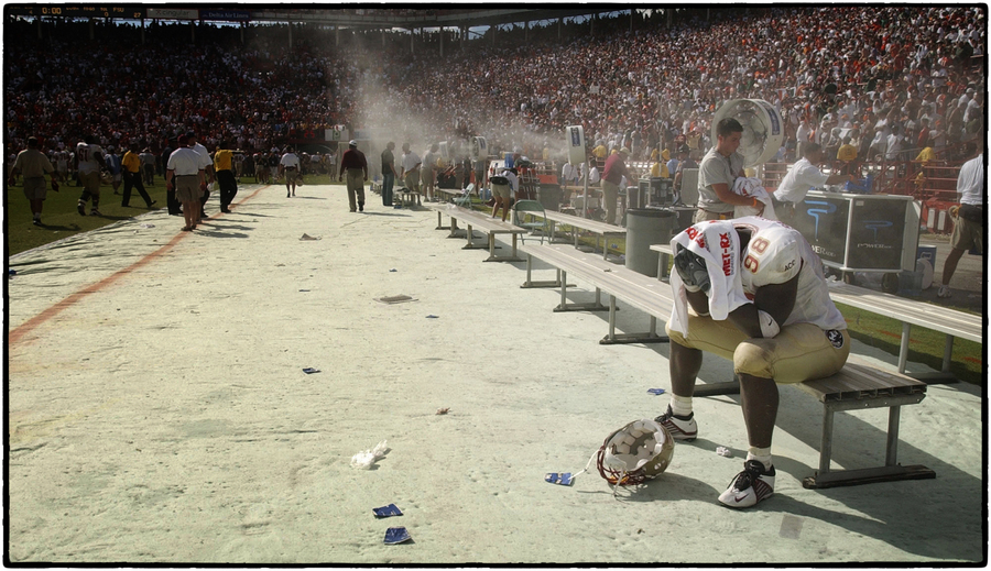 A FSU player reacts after a lost football game. : The Sports Sessions : Oklahoma City Editorial and Documentary Photographer