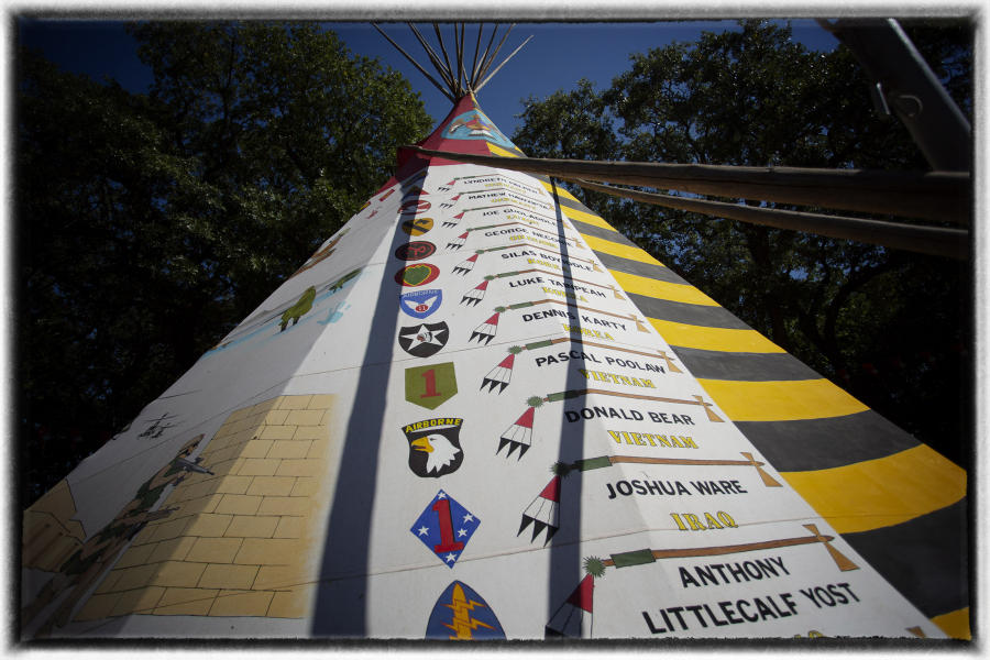 A list of the war dead is seen on the side of a tipi during the Veterans' Day ceremony in Anadarko, OK.  : Memorial Day : Oklahoma City Editorial and Documentary Photographer