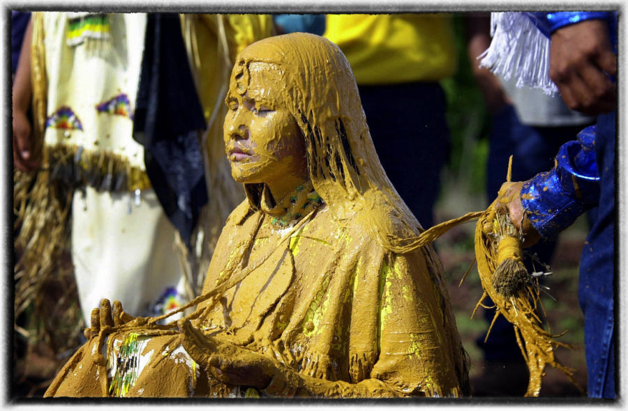 The girl is covered with a mixture of clay and corn meal that cannot be washed off during the ceremony. This is test of mental strength.  : Native Son : Oklahoma City Editorial and Documentary Photographer