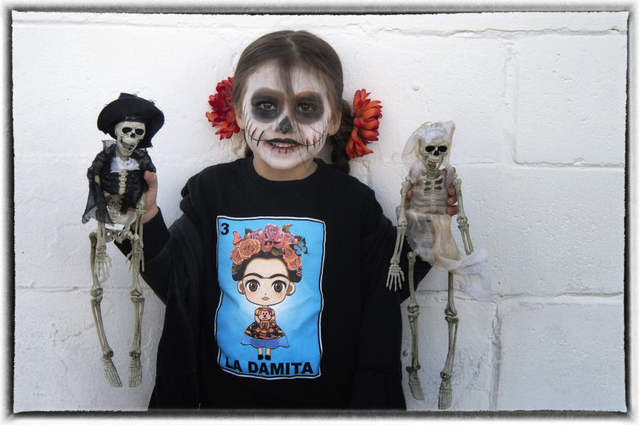 It is believed that happy spirits will provide protection, good luck and wisdom to families. : Dia de los Muertos  : Oklahoma City Editorial and Documentary Photographer