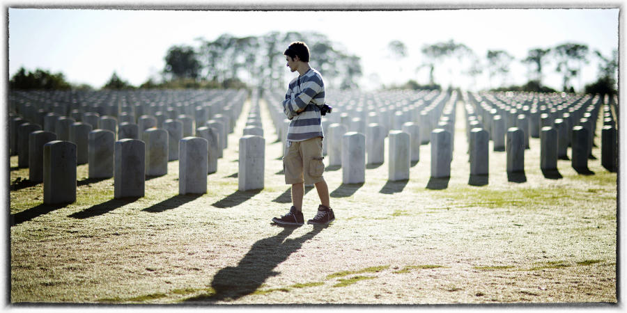 Walking through a national cemetery, remembering. : Memorial Day : Oklahoma City Editorial and Documentary Photographer